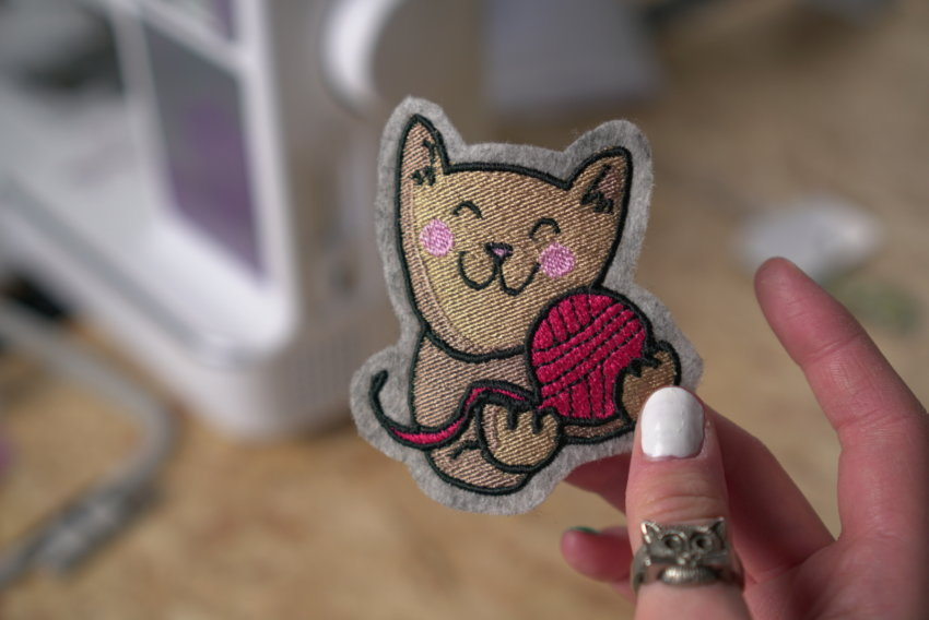 embroidery design cat with ball of wool